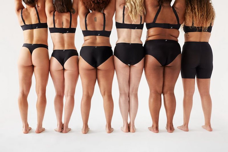 Six women of many sizes and ethnicities posing with Knix leak-proof underwear on, with various coverage silhouettes featured.